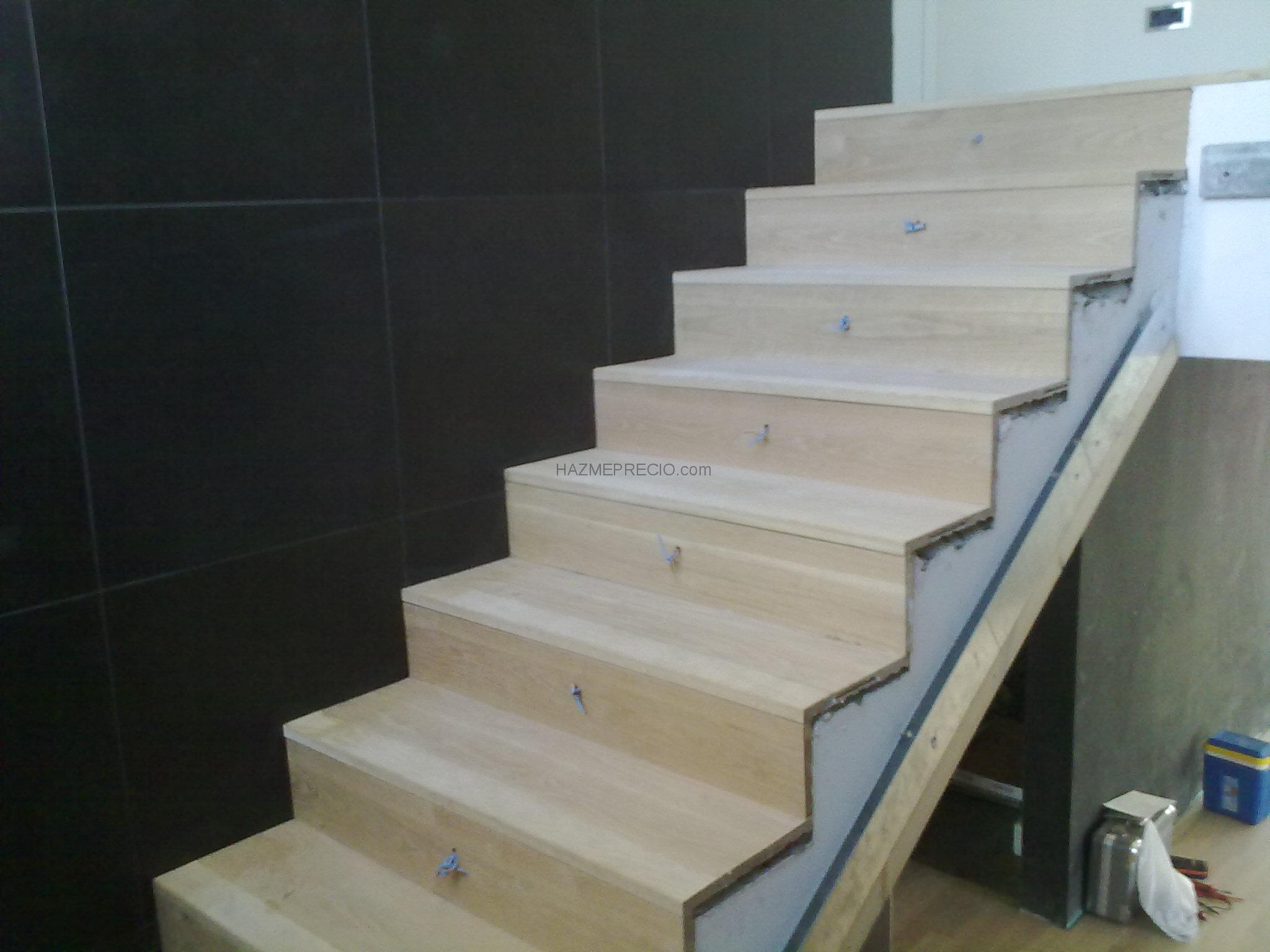 Empresas de tarima flotante en sevilla for Escalera electricista madera