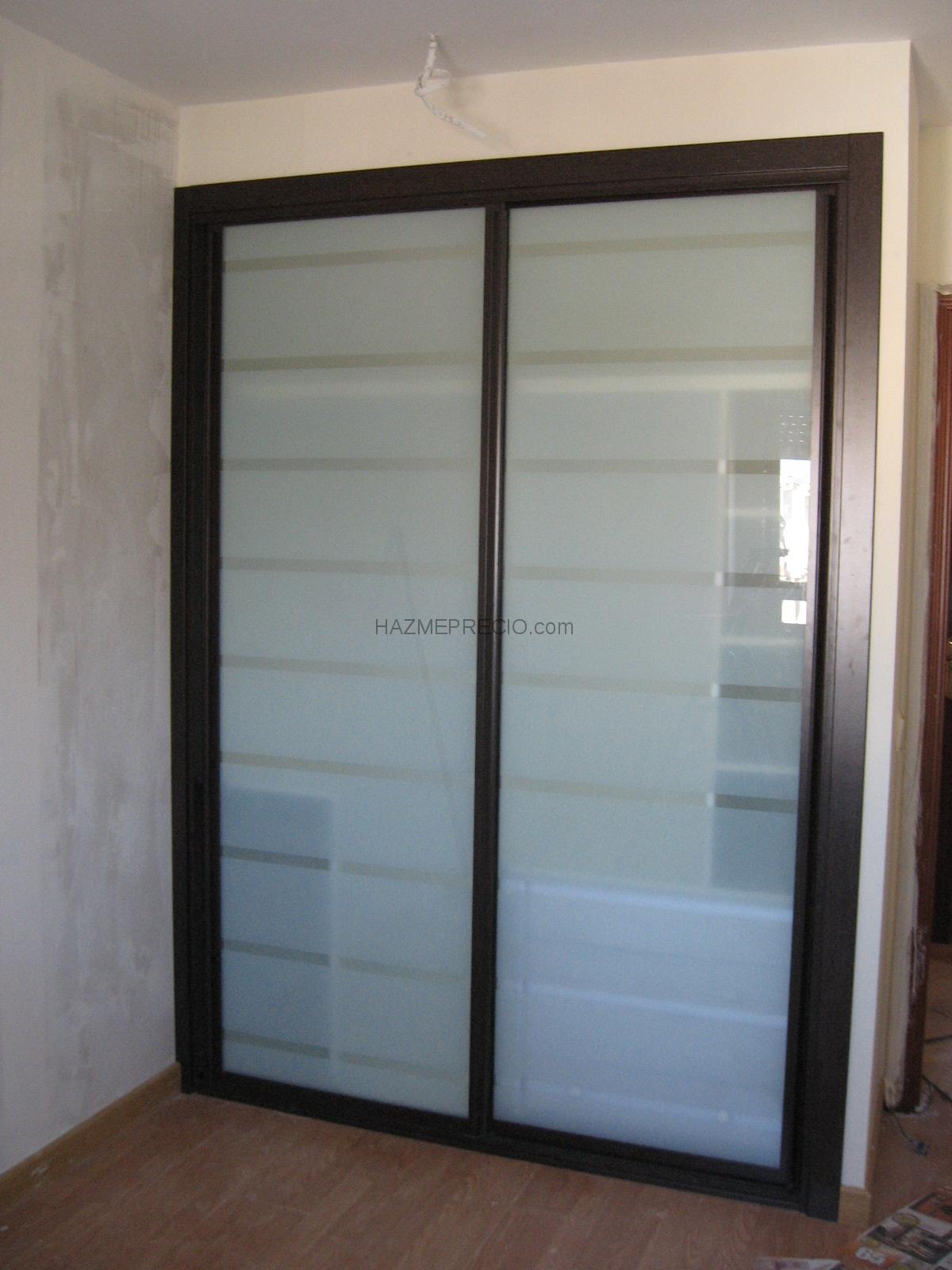 Arquimedes carpinteria 10200 trujillo caceres for Armario puertas correderas wengue