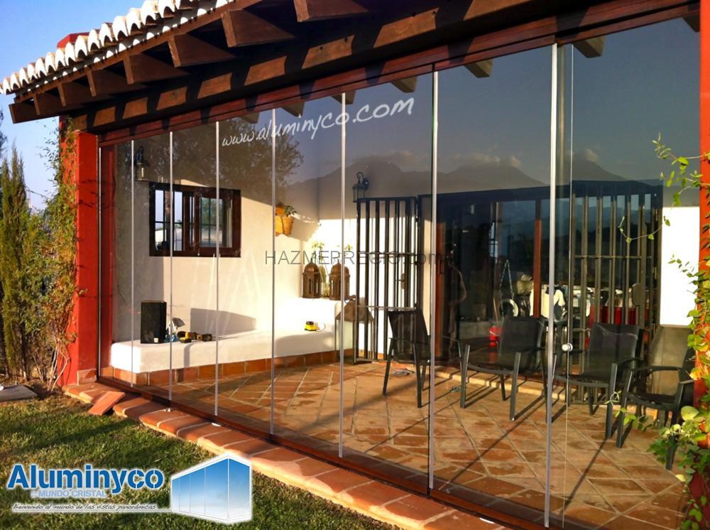 Acristalamientos y cerramientos aluminyco mundo cristal for Acristalamiento de terrazas precios