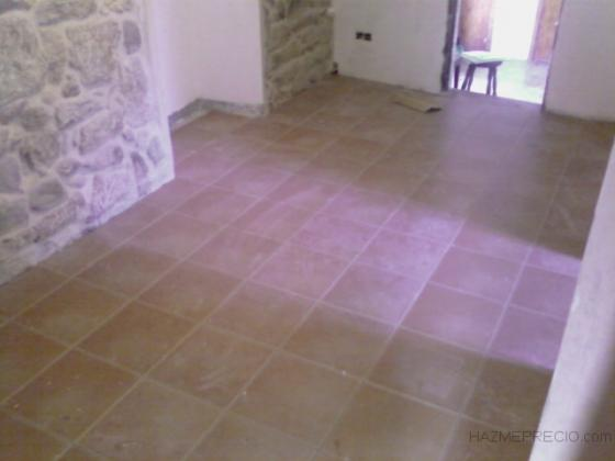 colocación pavimento y encintado de paredes