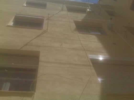 Picado de fachadas para revoco de mortero hidrófugo.