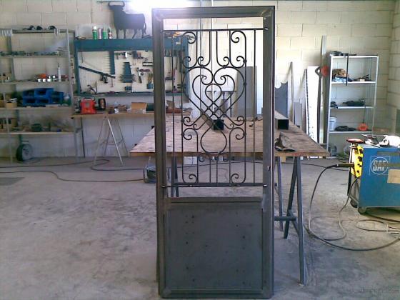 Anugar 50171 puebla de alfind n la zaragoza for Puerta garaje metalica