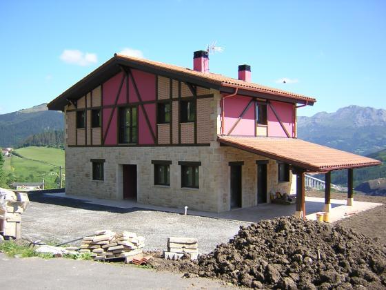 Construcción y reformas integrales ..( casa con porche construida en  Cantabria )