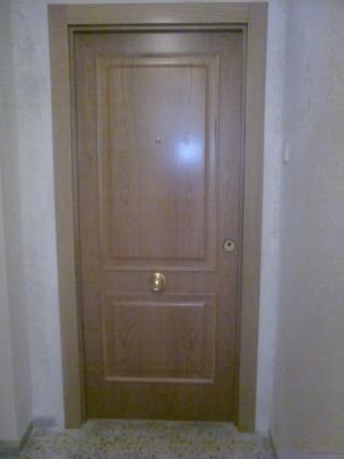 Cambio de puerta de entrada de seguridad y remates de 1º calidad