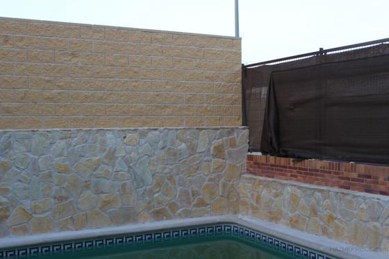 Construccion de muro con bloques de hormigon/Chapado paredes con piedra natural.