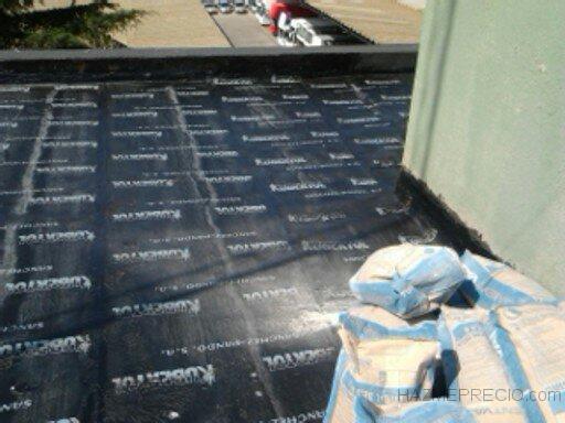 Impermeabilizacion de tejado de un edificio de oficinas en for Tela asfaltica precio m2