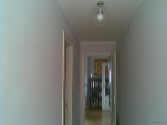 Alisado de piso en blanco roto
