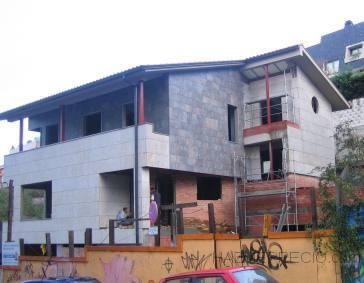 vivienda unifamiliar, bajo comercial y sotanos de garaje