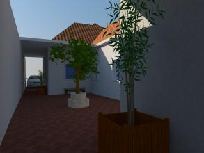 Patio interior de comunicación con la entrada y patio trasero, donde se crea una zona de descanso además de servir para iluminar las habitaciones interiores.