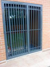 puerta abatible 2 hojas con cerradura