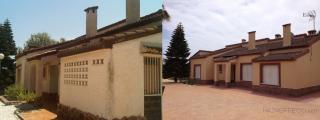 La fachada de toda la vivienda se ha aislado térmicamente por la parte exterior con un aislante proyectado, sobre el que se ha aplicado el revestimiento monocapa raspado en dos colores.
