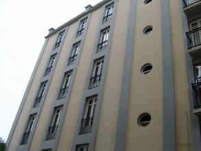 Cara este del edificio antes de pintar